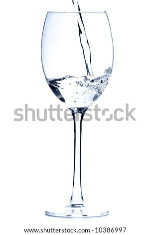 Wine glass with water over white background