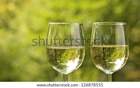 Wine glass, with white wine, picnic. - stock photo