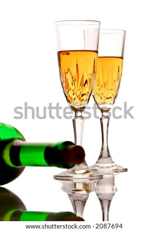 Wine glasses and a bottle of wine against white background - stock photo