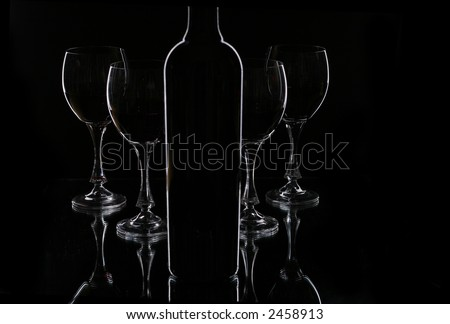Wine  glasses and bottle contour four glasses for  red wine - stock photo