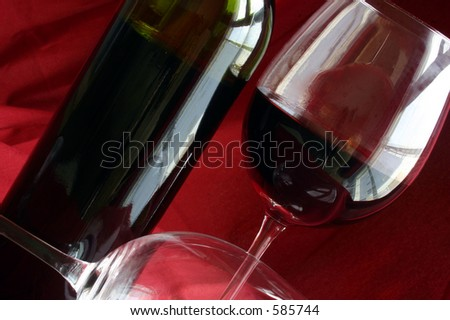 Wine glasses and bottle with red background