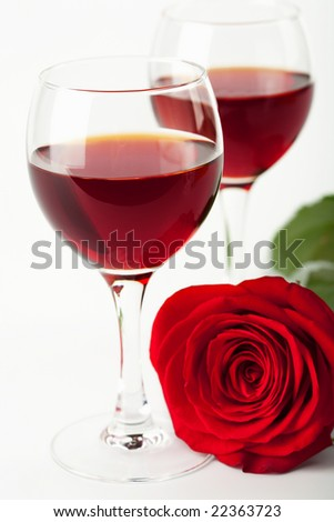 wine glasses and red rose - stock photo