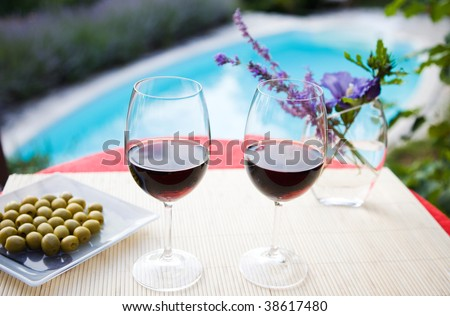 Wine glasses at the pool. Relaxing scene