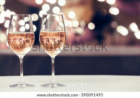 Wine glasses in a restaurant setting.  - stock photo