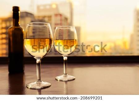 Wine glasses in romantic settings.  - stock photo