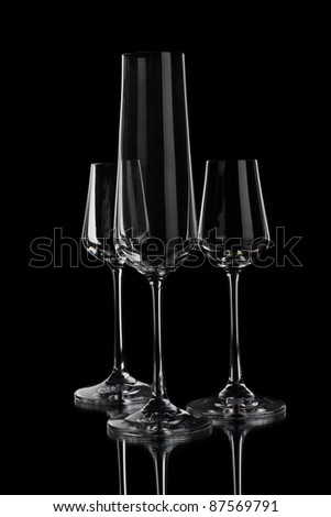 Wine glasses of different profile on a black background