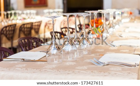 Wine glasses on a festive table in a restaurant in Rome. Italy - stock photo