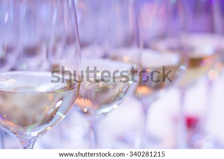 wine glasses on a table - stock photo