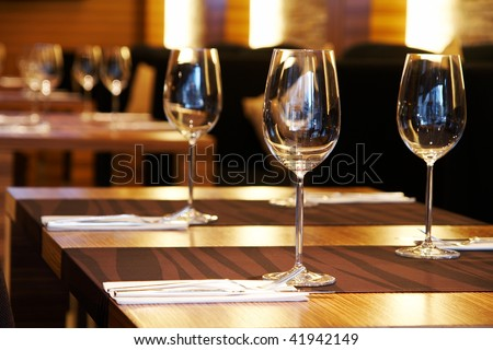 Wine glasses on a table in a restaurant - stock photo