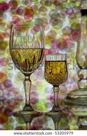 Wine glasses on beautiful colorful bubble background - stock photo