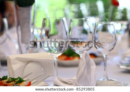 Wine glasses on luxury banquet table - stock photo