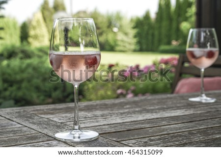 wine glasses on table at garden - stock photo