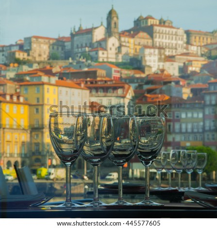 Wine glasses on the background of the city - stock photo