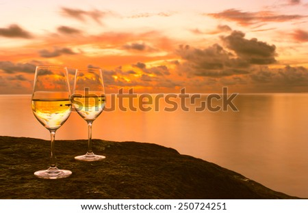 Wine glasses on the beach - stock photo
