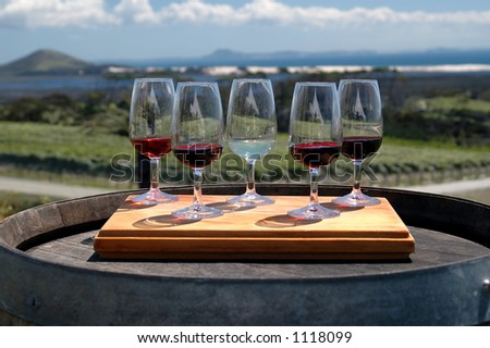 Wine glasses outside on tray - stock photo