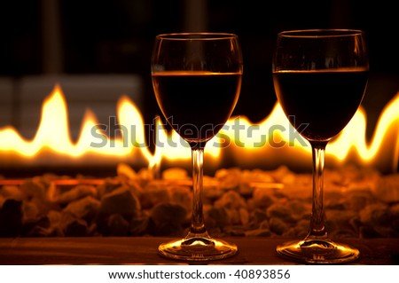 Wine glasses with fire on the background - stock photo