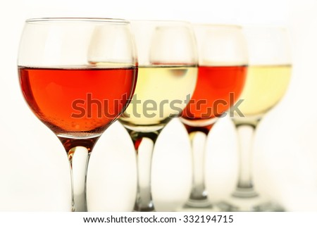 wine glasses with rose and white wine