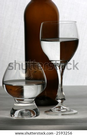 Wine  glasses with water and bottle - stock photo