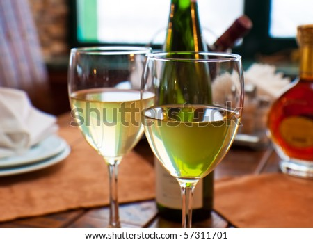Wine goblets on restaurant table. Shallow DOF - stock photo
