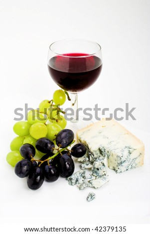 Wine grapes and cheese still life isolated on white