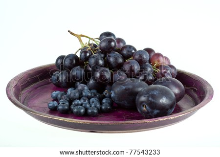 Wine grapes and fruits. - stock photo