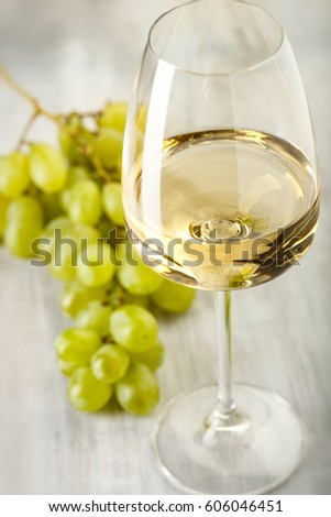 Wine. Grapes. Glass with white wine