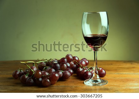 wine grapes on wood teble - stock photo