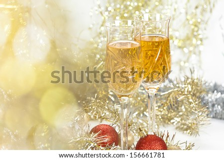 Wine in a glasses with new year decorations and front bokeh