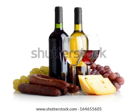 Wine in bottles and glasses, grapes, cheese an sausage isolated on white