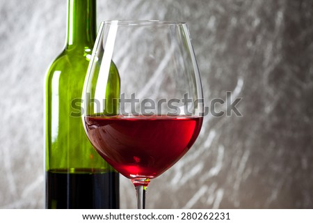 Wine in glass and bottle - stock photo