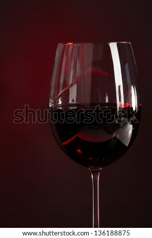 Wine in glass on dark background