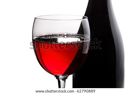 Wine in glass white and black bottle detail