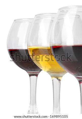 Wine in glasses close-up isolated on white - stock photo