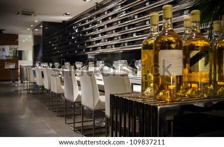 wine in interior of modern restaurant - stock photo