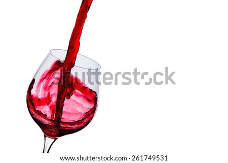 wine is poured into a glass on a white background - stock photo