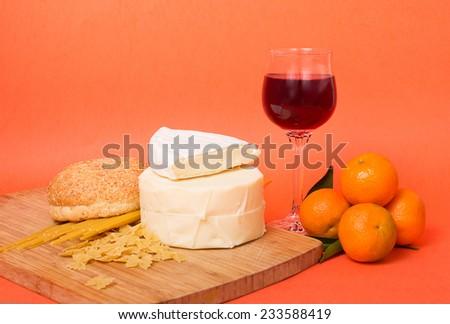 Wine, Italian pasta and red wine on the orange background - stock photo