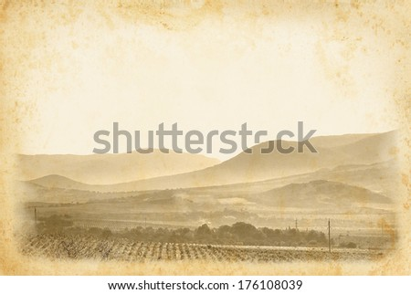 Wine label for your design. Vintage wine poster at old paper background. Ancient framed page with vineyard and mountain landscape. - stock photo