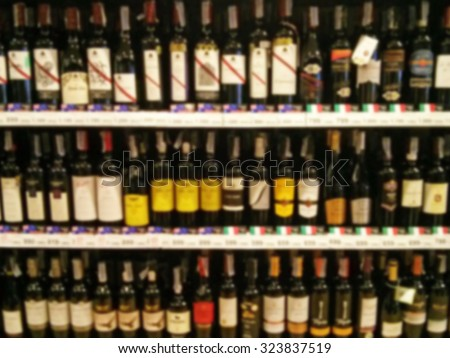 Wine Liquor bottle on shelf and Blurred background - stock photo