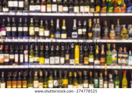 Wine Liquor bottle on shelf - Blurred background - stock photo