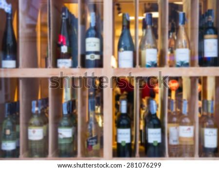 Wine Liquor bottle on shelf - Blurred background - stock photo