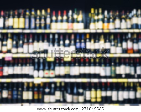 Wine Liquor bottle on shelf,  Blurred Bar Restaurant background - stock photo