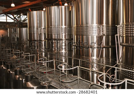 Wine making vats and equipment in tour of winery - stock photo