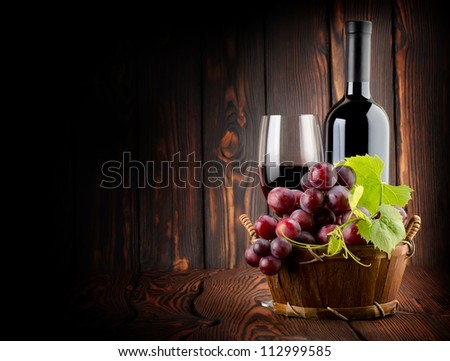 Wine on the old wooden background - stock photo