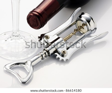 Wine-opener glass and bottle. - stock photo