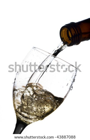 Wine pouring into a glass isolated on white