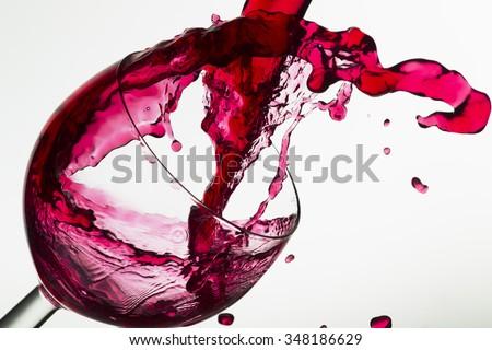 Wine pouring into a glass, studio lighting, Macro - stock photo