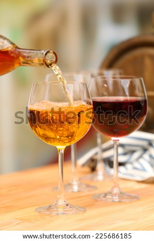 Wine pouring into wine glass, close-up - stock photo