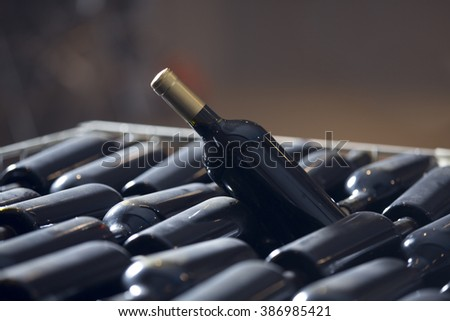 Wine.Preparing Wine. Red wine and a bottle - stock photo