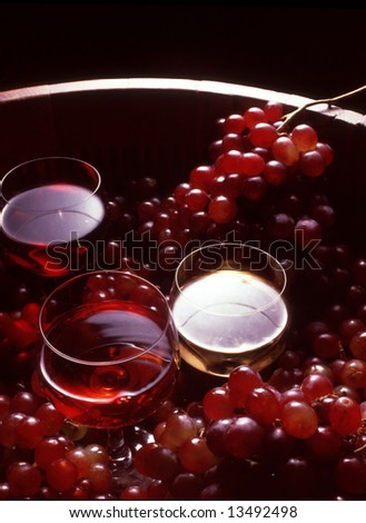 Wine: several wine glasses, grapes, and a wine barrel.