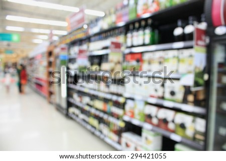 wine shelves in supermarket blurred background - stock photo